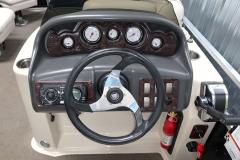 Driver's Console of a 2010 Premier 225 Sunsation LTD RF Pontoon Boat