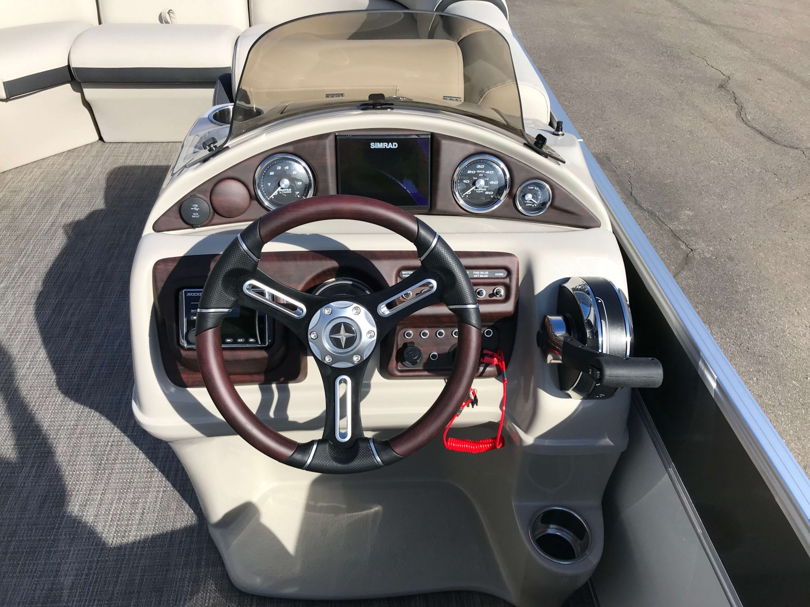 Drivers Console with Touchscreen Simrad GPS of a 2019 Berkshire 23RFX STS Pontoon