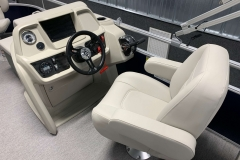 Helm and Captain's Chair of a 2020 SunChaser Vista 18 Fish Pontoon Boat