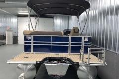 Blue and Tan Exterior of a 2020 Sylvan L1 Cruise Pontoon 6