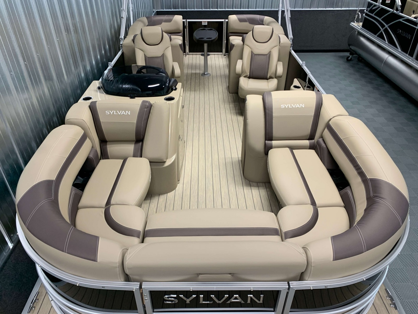 Tan Teak Weave Vinyl Flooring of a 2020 Sylvan L3 Cruise Pontoon