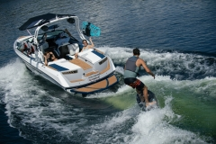 Wake Surfing Behind the 2021 Nautique 210 Wake Boat