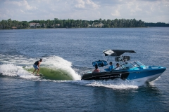 Wake Surfing Behind the 2021 Nautique 230 Wake Boat
