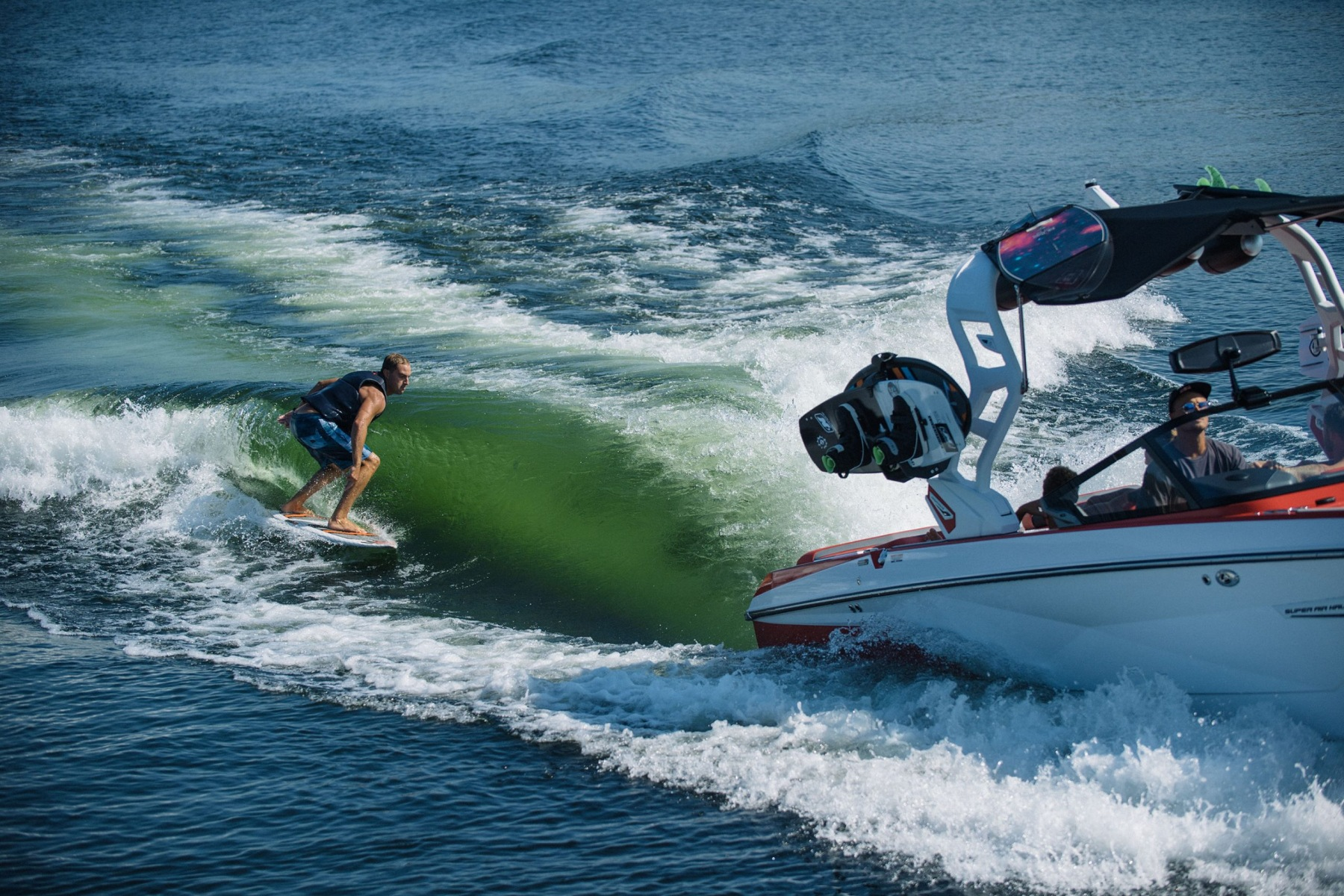 Wake Surfing Behind the 2021 Nautique G23 Wake Boat