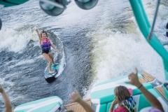 Wake Surfing Behind the 2021 Nautique G23 Wake Boat