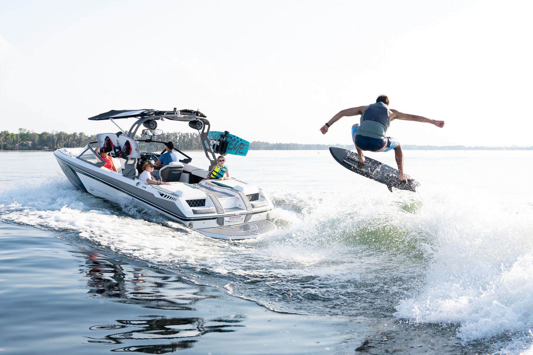 Wake Surfing Behind a 2021 Nautique GS20 Wake Boat